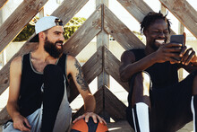 Friends Talking After Playing Basketball