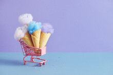 Cotton Candy In Colorful Ice Cream Cones Isolated On Pastel Colorful Background