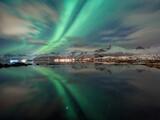 Northern lights on lofoten islands reflection