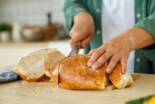 Crop Person Slicing Fresh Bread
