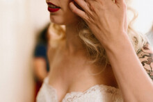 Close Up Of Bride With Dark Red Lips Getting Ready For Wedding Day