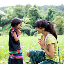Young Girl From The Hill Tribes Of Thailand, Greets Tourist. Thailand