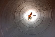 Construction Worker Inspecting Water Pipeline. India.