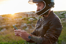 Man Using A Phone While Out For A Motorbike Ride