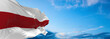 Large flag of belarus  waving in the wind on flagpole against the sky with clouds on sunny day. 3d illustration