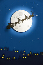 Santa Claus Get A Move To Ride On Their Reindeer. Magic Santa's Sleigh Flying Over Christmas Fairy Forest On The Background Of Huge Moon.