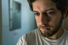Indoor Portrait Of A Worried Man