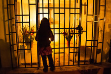 A Girl Leans Toward A Grave Site At Night