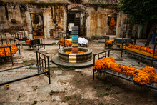 An Old Courtyard With Marigolds Drying