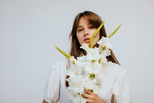 Charming Model With Bouquet Of White Gladioluses