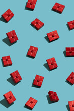 Red Christmas Gift Pattern On Blue Background