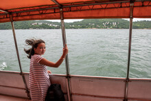 Girl Riding On Boat In Hong Kong