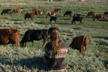 Girl On The Background Of Cows In The Field
