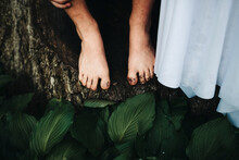 Boy Standing Next To Bride With Dirty Feet