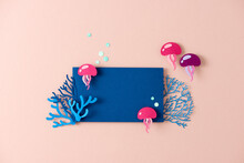 Coral Reef Copy Space Frame Template With Colorful Papercut Jellyfish On Pink Background.