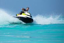 A Man On A Jetski In The Maldives
