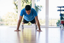 Man In Blue T-shirt Doing Plank Exercise