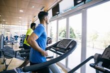 Men Using Treadmills