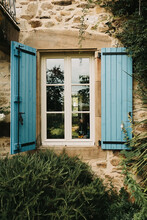 Close Up Of An Old Farm House In France With Beautiful Blue Shutters