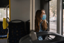 Woman In Bus Wearing Surgical Mask