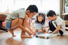 Kids Playing Puzzles At Home
