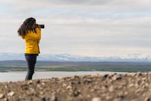 Girl Enjoying Landscape Of A Lake