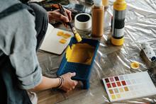 Crop Woman Mixing Dye In Tray