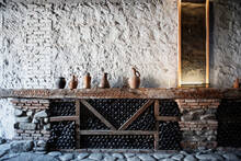 Ceramic Jugs On Wine Shelf