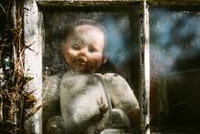 Slightly Creepy Baby Doll At A Window