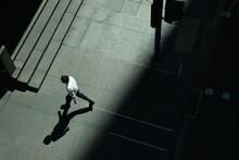 Man Walking In Pavement
