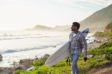 Surfer Exploring The Coastline