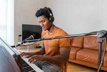 Man Wearing Headphones Playing The Piano