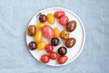 Colored Cherry Tomatoes On A Plate