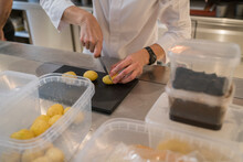 Chef Cutting Potatoes