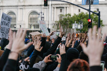 A Crowd With Their Hands In The Air