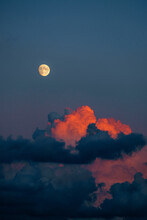 98% Full Moon With Red Clouds