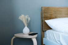 Bedside Table With Phone And Plant