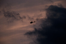 A Police Helicopter At Sunset.