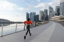 Asian Woman Exercising Outdoors