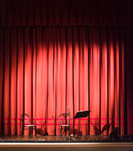 Chairs And Microphone On The Stage At Theater