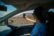 Taking A Selfie During A Road Trip In The Desert.