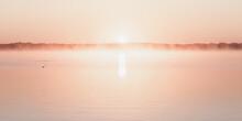 Serene Pink Sunrise Over Lake
