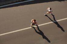 Women Running On Street