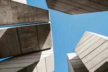 Minimal Concrete Geometrical Architectural Structures Against Blue Sky