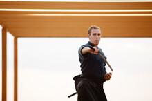 Samurai Practicing With Sword In Gazebo