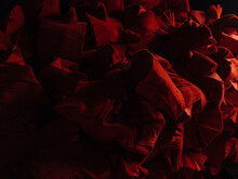 Packed Layers Of Red Textile