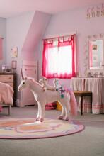 Unicorn Stuffed Animal In Girls Bedroom