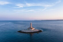 Lighthouse On A Small Rocky Island Off The Coast Of Croatia