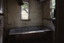 A Dirty Old Bath Tub In An Abandoned Cottage In The Countryside