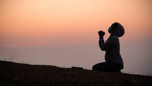 Woman Prayed At Sunset In The Mountains